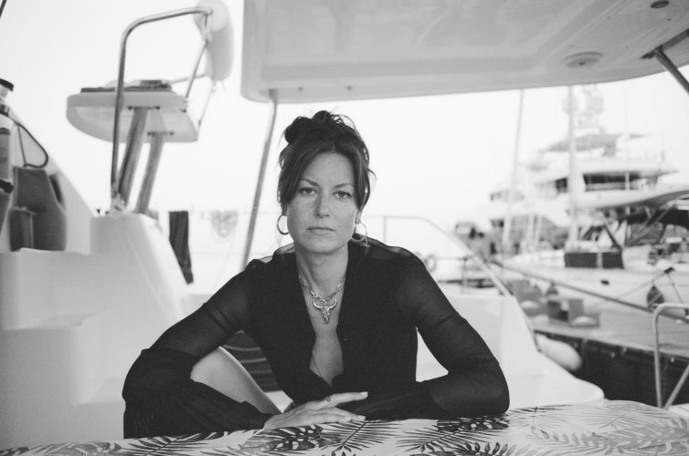 Woman photographer Magdalena Wosinska on a boat