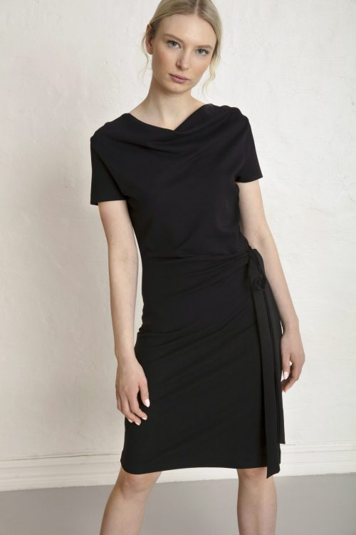 Girl in black sustainable dress