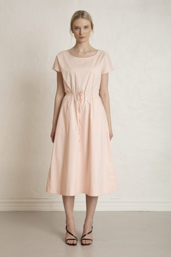 Woman in sustainable pink sateen dress and heels