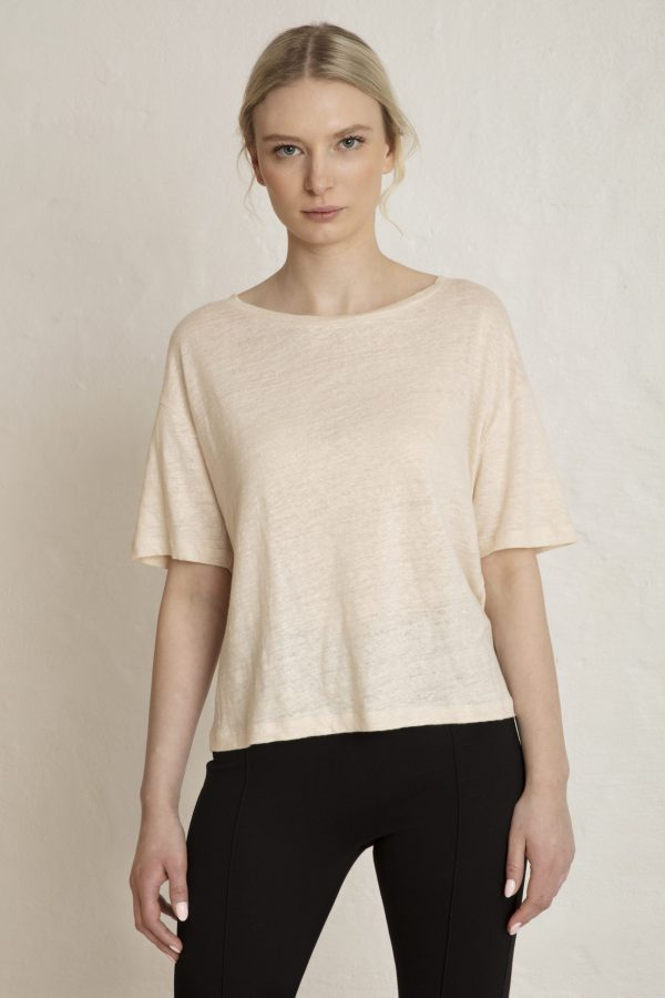 Woman in white linen tee and black ecovero pants