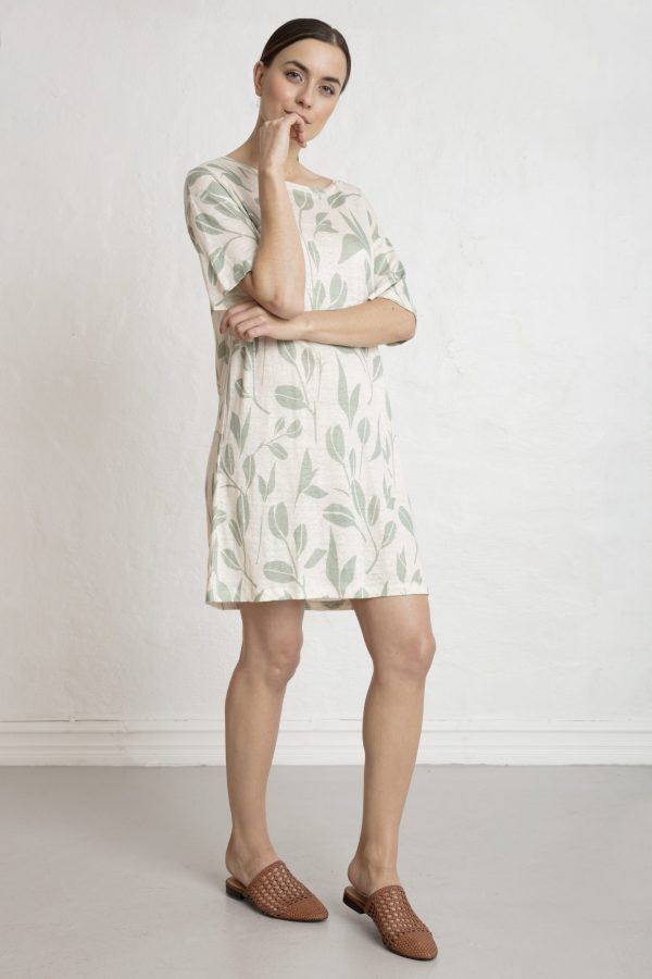 Woman in printed white linen tee dress