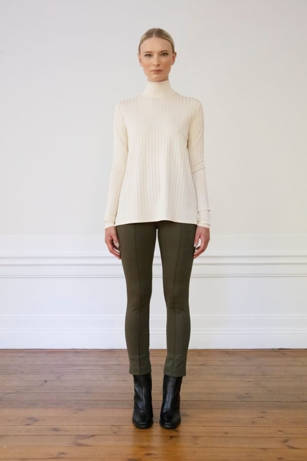 Lou ecovero straight pants ink green and sauna rib top white sand styled with heel boots