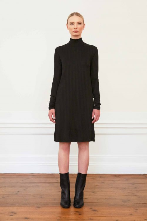 Girl wearing Silas rib dress in color black. Styled with black leather boots