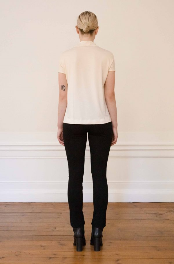 Luca tencel top white with lou ecovero straight black pants from the back