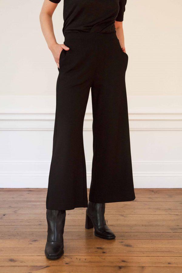 Girl wearing Lottie ecovero wide pants in color black