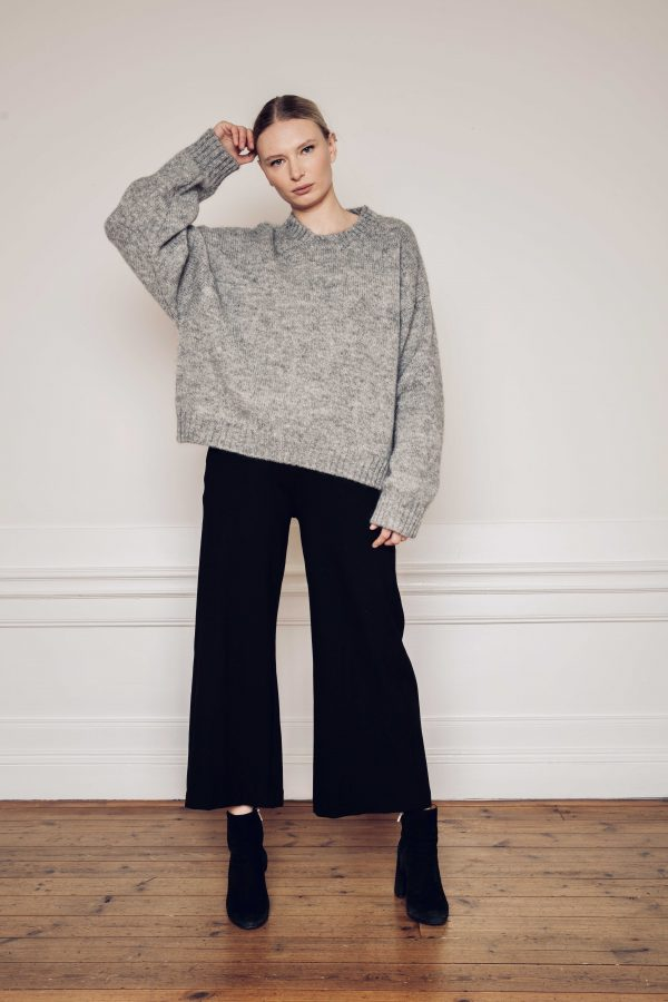 Ire knitted grey sweater with Lottie wide black pants styled with heel boots