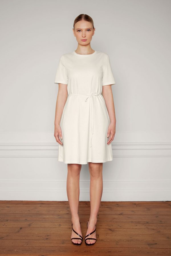 Ofelia Cotton Dress in color shell tied from the front