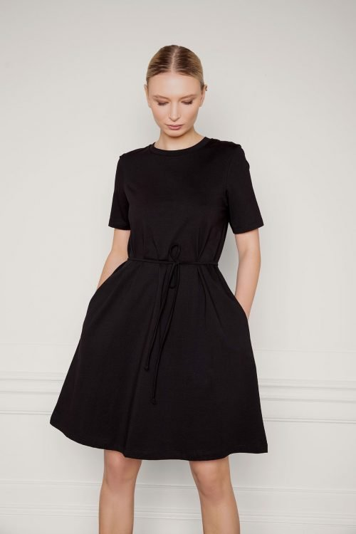 Girl wearing Ofelia Organic Cotton Dress Black tied