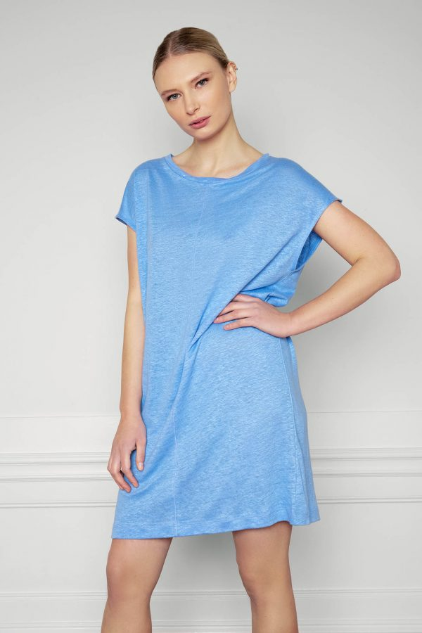 Girl wearing Residus Winnie Linen Dress Corn Blue