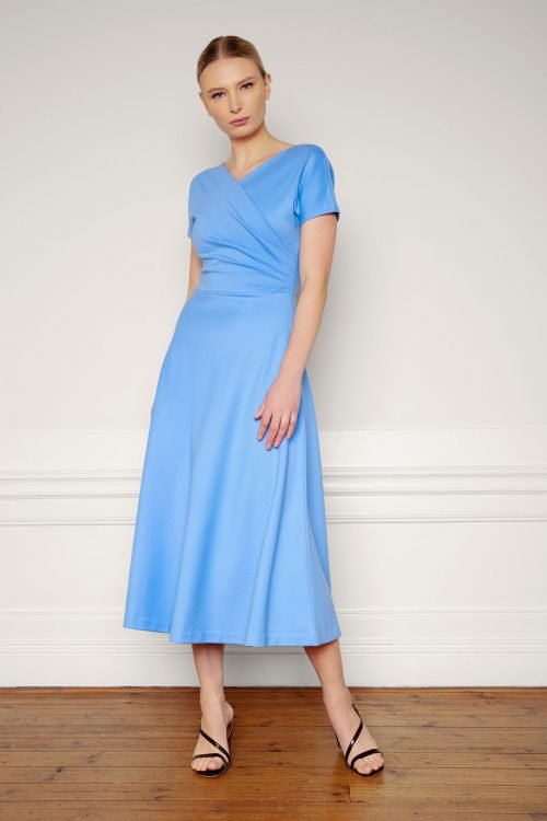 Girl wearing Anis Ecovero Dress in color Corn Blue