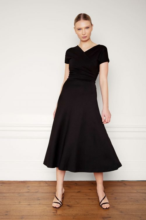 Girl wearing Anis Ecovero Dress in color Black
