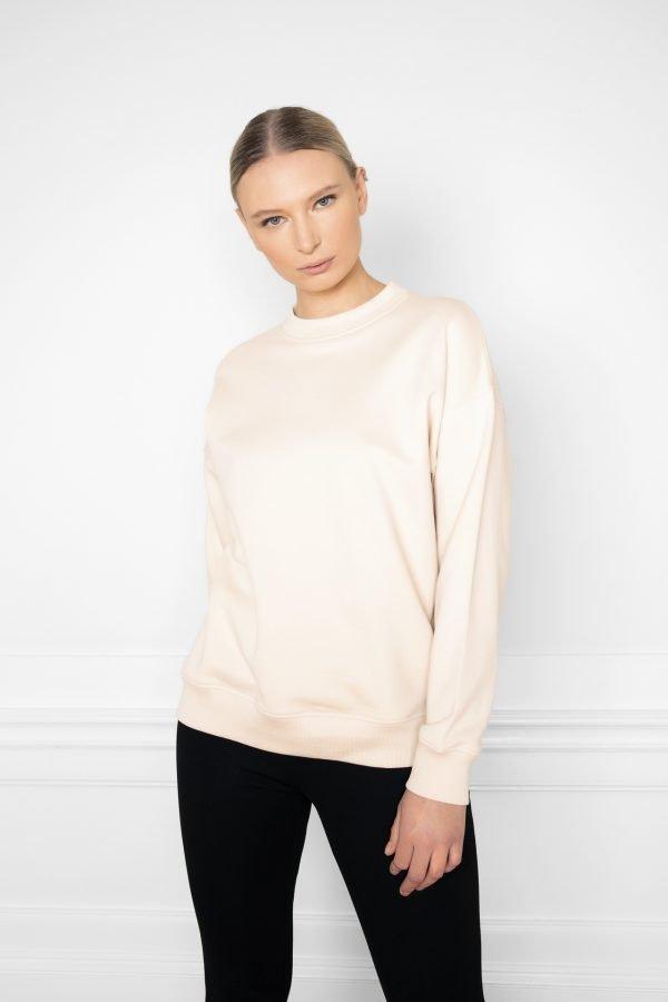 Girl wearing Ricon White Sand Sweatshirt