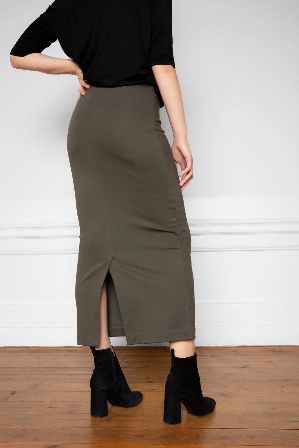 Girl wearing Lala EcoVero Skirt Ink Green from the back