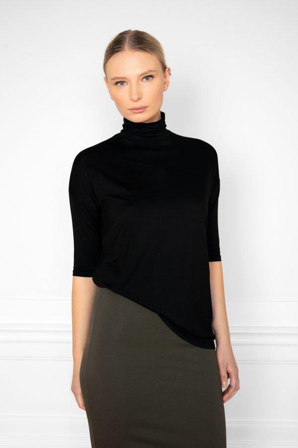 Girl wearing Tomasine Tencel Turtleneck Black with Lala Skirt Green