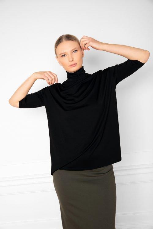 Girl wearing Tomasine Tencel Turtleneck in Black