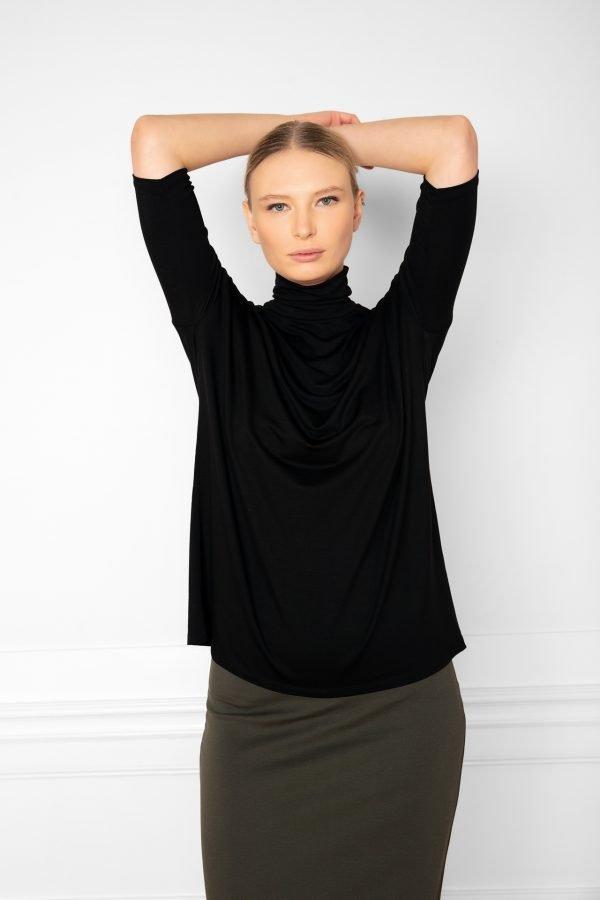 Girl wearing Tomasine Tencel Turtleneck in color Black