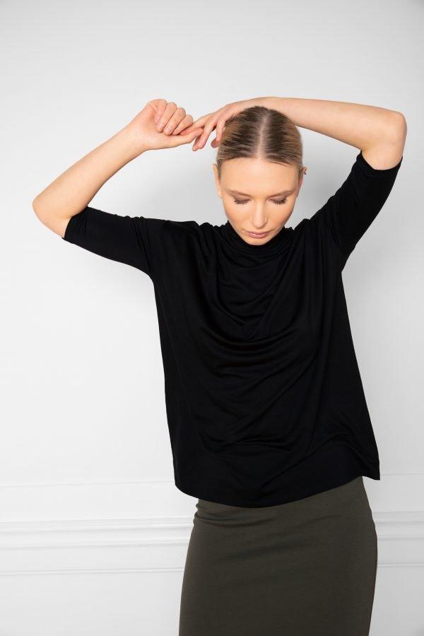 Girl wearing Tomasine Tencel Turtleneck Black