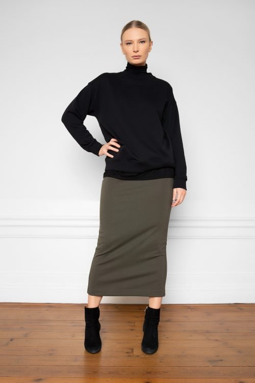 Girl wearing Lala Ecovero Ink Green Skirt with Tomasine Tencel Turtleneck Black and Ricon Sweatshirt Black
