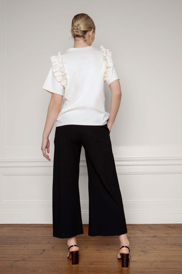 Opal Organic Cotton Ruffle Tee in Shell with Lottie Ecovero Black Pants from the back