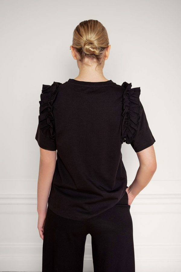 Opal Organic Cotton Ruffle Tee in Black with Lottie Ecovero Black Pants close up from the back