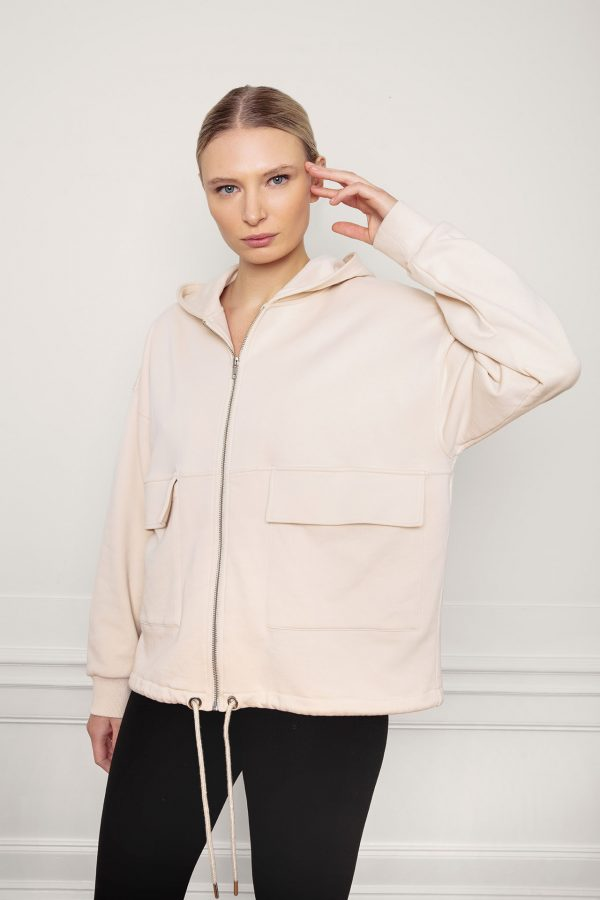 Girl wearing RobinSweat Jacket in color White Sandwith front zip, hood and pockets
